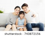 happy family watching tv in... | Shutterstock . vector #743872156