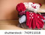 the pile of winter cloths | Shutterstock . vector #743911018