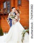 newlyweds on a winter walk. the ... | Shutterstock . vector #743934382
