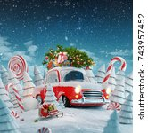 red santa's car with gift boxes ... | Shutterstock . vector #743957452