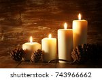 burning candles and pine cones...   Shutterstock . vector #743966662