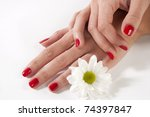manicure woman hand with white flower - stock photo