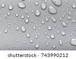 drops of water on a color... | Shutterstock . vector #743990212
