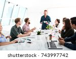 team of businessmen work... | Shutterstock . vector #743997742