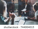 business people brainstorming... | Shutterstock . vector #744004015