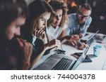 project team working together... | Shutterstock . vector #744004378