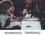 team of young coworkers work... | Shutterstock . vector #744004462