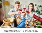 group of friends enjoying... | Shutterstock . vector #744007156