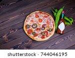 juicy vegetables and hot pizza...   Shutterstock . vector #744046195