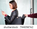 thief picking the wallet from... | Shutterstock . vector #744058762