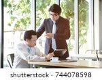 stressed asian business man... | Shutterstock . vector #744078598