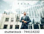 serious businessman looking on... | Shutterstock . vector #744114232