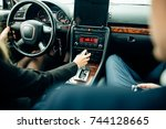 driving instructor and woman... | Shutterstock . vector #744128665