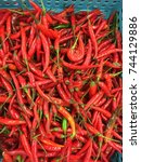 Small photo of Bird Chilli or Bird's Eye Chilli or Chilli Padi or Thai Pepper or Capsicum Annum, on sale and displayed in a supermarket