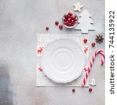 christmas decor of the table.... | Shutterstock . vector #744135922