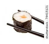 Salmon sushi roll in chopsticks isolated on a white studio background - stock photo
