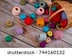 colorful yarn spools and... | Shutterstock . vector #744160132