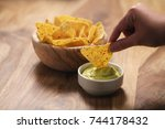 young female hand dipping... | Shutterstock . vector #744178432