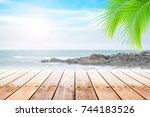 empty wooden table and coconut... | Shutterstock . vector #744183526