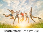 the five friends jumping on the ... | Shutterstock . vector #744194212