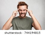 headshot of young man holds... | Shutterstock . vector #744194815