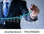 businessman presenting a... | Shutterstock . vector #744198685