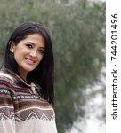 Small photo of Smiling Peruvian Latina Woman