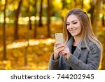 young blond woman in autumn... | Shutterstock . vector #744202945