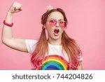 arrogant pretty woman in pink... | Shutterstock . vector #744204826