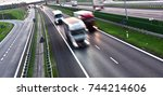trucks on four lane controlled... | Shutterstock . vector #744214606