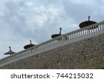 umbrellas on a pier near the... | Shutterstock . vector #744215032
