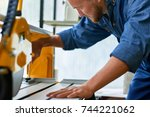 portrait of workman setting up... | Shutterstock . vector #744221062