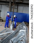 workers at the plant load the... | Shutterstock . vector #744230392
