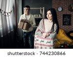 couple on christmas | Shutterstock . vector #744230866
