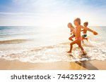 cute kids having fun on sandy... | Shutterstock . vector #744252922