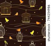 Golden Birds And Birdcage On A...