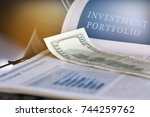 investment portfolio.... | Shutterstock . vector #744259762