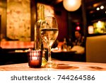 wine glass  bottle and candle...   Shutterstock . vector #744264586