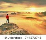 hiker in black on the rocky... | Shutterstock . vector #744273748