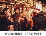 group of happy friends having...   Shutterstock . vector #744279055
