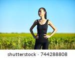 slim athletic asian woman... | Shutterstock . vector #744288808