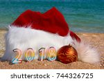 santa claus hat and toys on... | Shutterstock . vector #744326725