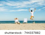 woman and man relaxing on beach | Shutterstock . vector #744337882