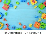 pieces of math puzzle scattered ... | Shutterstock . vector #744345745