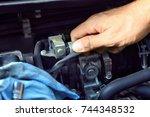 car mechanic providing car... | Shutterstock . vector #744348532