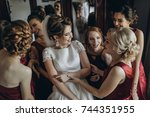 beautiful bride   bridesmaids... | Shutterstock . vector #744351955