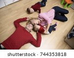family in the playroom lies on ...   Shutterstock . vector #744353818