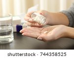 close up of a woman taking a... | Shutterstock . vector #744358525