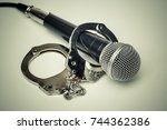 a microphone with handcuffs  ... | Shutterstock . vector #744362386