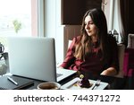 young attractive woman sitting... | Shutterstock . vector #744371272
